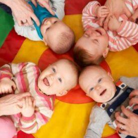 Overhead View Of Babies Having Fun At Nursery Playgroup