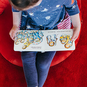 Child reading a picture book