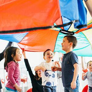 young children under a parachute