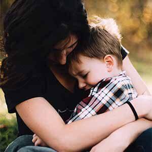 mom comforting son