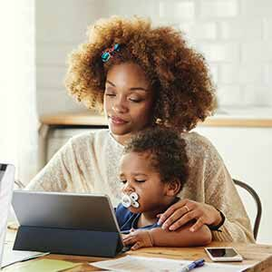 mom and toddler with ipad